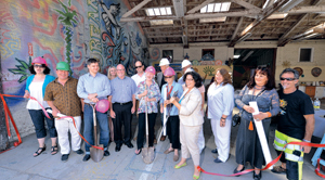 Members of the Santa Barbara Arts Collective, the Summer Solstice Celebration and dignitaries, including Santa Barbara Mayor Helene Schneider, attend Friday's ribbon-cutting for the new home of the Solstice Parade.STEVE MALONE/NEWS-PRESS PHOTOS
