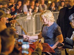 Patricia Arquette signs autographs for the fans.