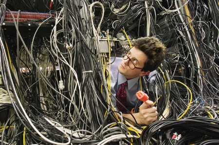 male-it-worker-buried-in-computer-cable_450