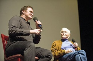 Above, Quentin Tarantino and Kirk Douglas are shown speaking at the Lobero Theatre on Sunday. At right, the two shake hands backstage after the Q & A session.