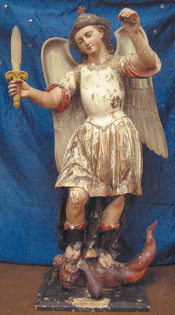 This statue of St. Michael (San Miguel) slaying a devil (or is it just a snake?) is about three feet tall and made of wood, gesso and polychrome. Courtesy photos