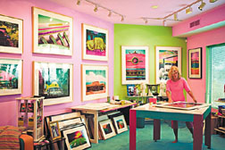 Photographer/collagist Jane Gottlieb has turned the walls, ceilings and floors of her Riviera home into a splash of vibrant colors, just like her paintings. Below, Penelope Gottlieb works on her series of vanishing plant species.