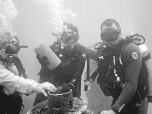 You can become part of the ocean's ecosystem by being buried at sea in a living coral reef or an artificial ocean reef cast of concrete mixed with your ashes. These divers are interring ashes at the Neptune Memorial Reef, located off the Miami, Fla., coast. COURTESY NEPTUNE MEMORIAL REEF