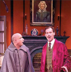 "Joseph Fuqua, right, and Jamie Torcellini, left, fashioned one of the umpteen wardrobe combos in Ensemble Theatre's production of ""Irma Vep"" over the weekend at Alhecama Theatre. DAVIDBAZEMORE.COM PHOTO"