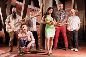Dengue Fever has always made Santa Barbara part of their touring itinerary and this time is no different. The band includes, from left, Zac Holtzman (guitar and vocals), Paul Smith (drums), Ethan Holtzman (keys), Chhom Nimol (vocals, front), Senon Williams (bass) and David Ralicke (horns).