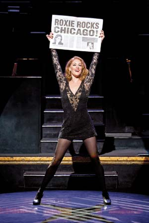 Dylis Croman plays the role of Roxie Hart.