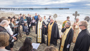 A group from St. Athanasius Antiochian Orthodox Church takes part in a Blessing of the Ocean ceremony on Sunday. NIK BLASKOVICH / NEWS-PRESS