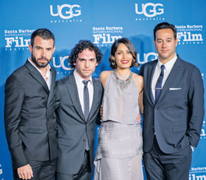From left, cast members Tom Cullen, Reece Ritchie and Freida Pinto join director Richard Raymond on the red carpet.