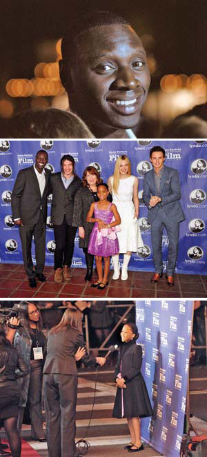 "Omar Sy, nominated for his performance in ""The Intouchables,"" arrives on the red carpet. Mr. Sy, Ezra Miller, Ann Dowd, Quvenzhane Wallis, Elle Fanning and Eddie Redmayne pose on the red carpet before the Virtuosos Award. Below, Quvenzhane speaks with an interviewer outside the Arlington. THOMAS KELSEY / NEWS-PRESS"